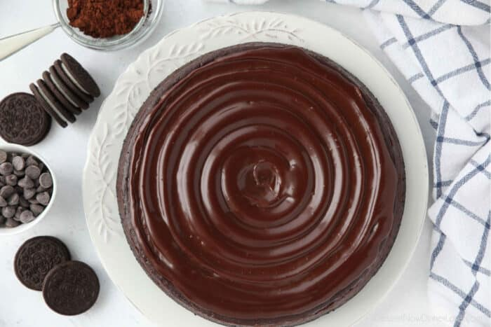 Swirled ganache on top of chocolate cheesecake.