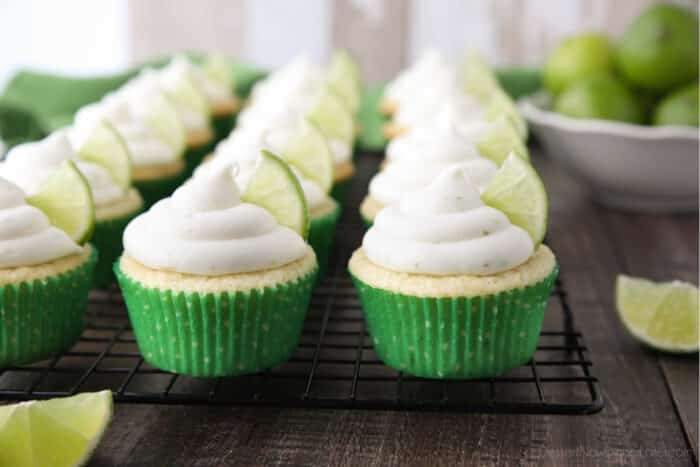 Frosted Key Lime Cupcakes on wire cooling rack.