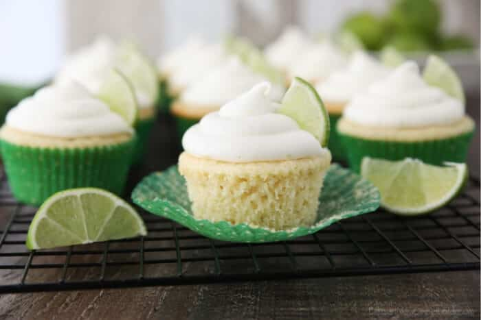 Key lime cupcake on wrapper that has been peeled down on the sides.