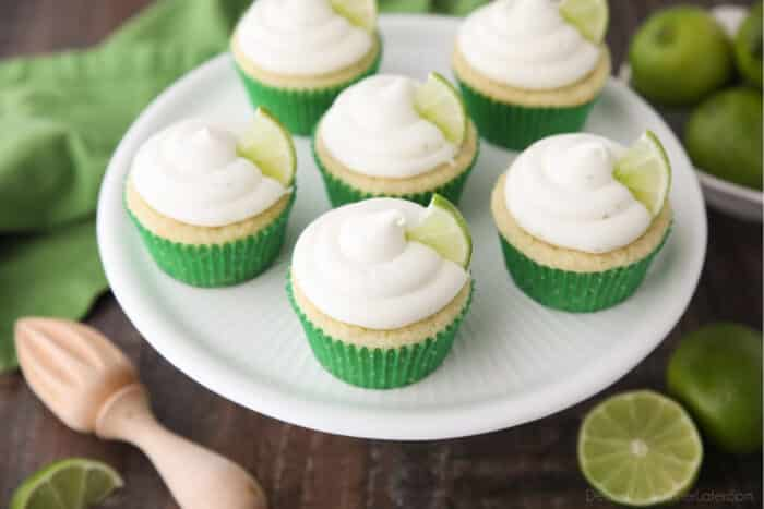 Top view of key lime cupcakes on cake stand.