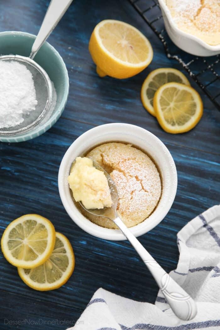 Spoonful of lemon pudding cake in ramekin.