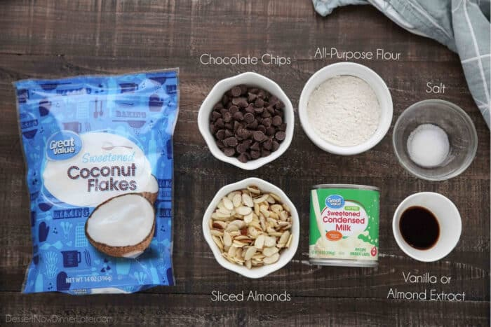 7 ingredients for Almond Joy Cookies: Shredded coconut, chocolate chips, sliced almonds, sweetened condensed milk, all-purpose flour, salt and vanilla or almond extract.