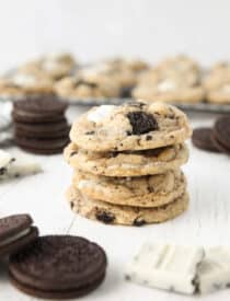 Four cookies and cream cookies stacked on top of each other.