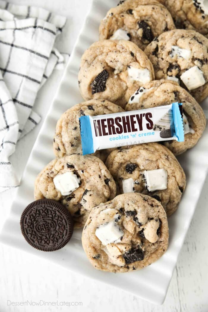 Plate of cookies and cream cookies with an Oreo and Hershey's Cookies 'n' Creme candy bar.