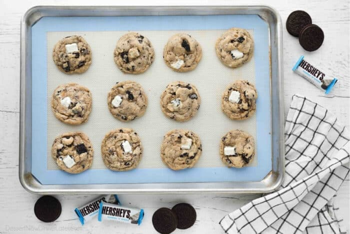 Cookie tray with baked cookies and cream cookies. Oreos and Hershey's Cookies 'n' Creme candy bars on the side.