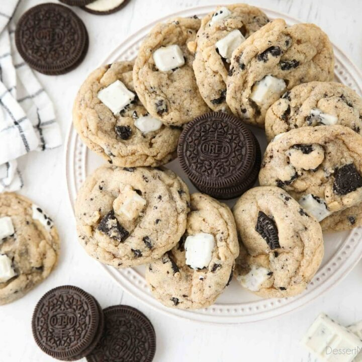 Plate of cookies and cream cookies with a stack of Oreos in the middle.