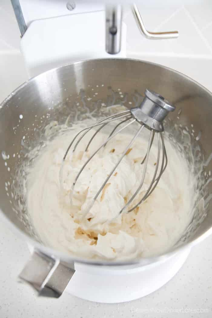 Whisk full of whipped cream cheese frosting in the mixing bowl.