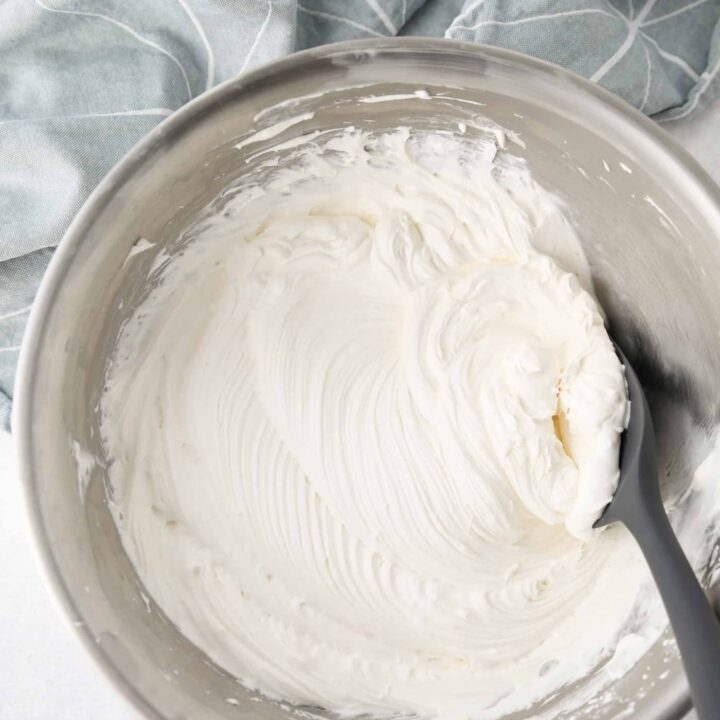 Bowl with ripples of cream cheese whipped cream frosting.