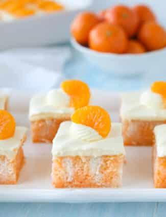 Close up of a slice of orange poke cake.