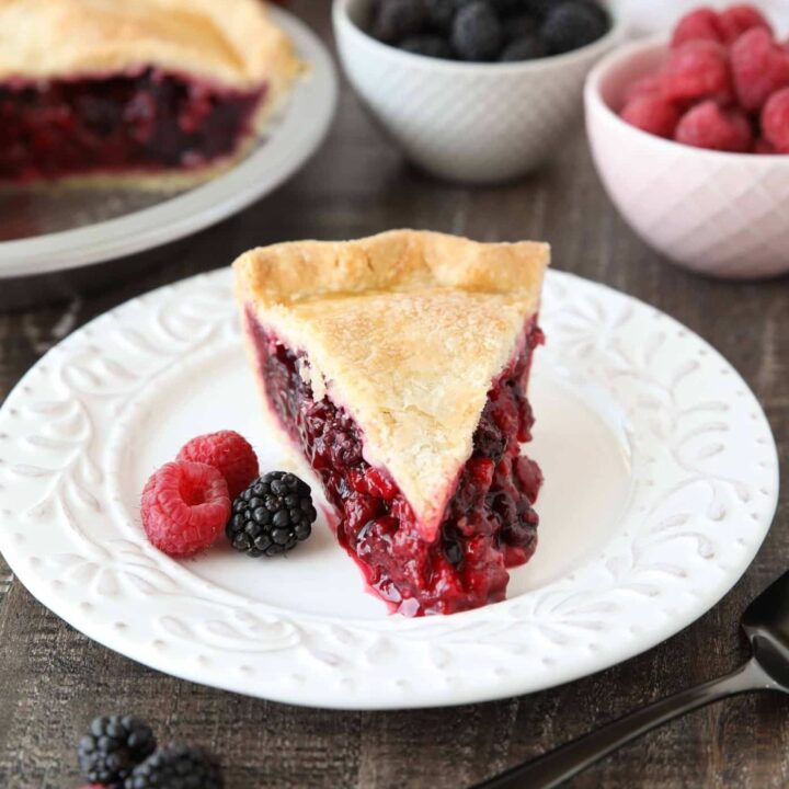 Slice of Razzleberry Pie on a plate. Focusing on the berry pie filling.