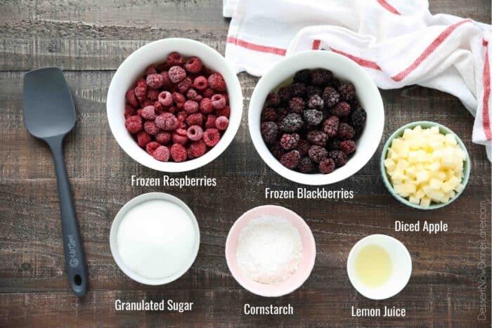 Ingredients for Razzleberry Pie - frozen raspberries, frozen blackberries, diced apple, granulated sugar, cornstarch, lemon juice.
