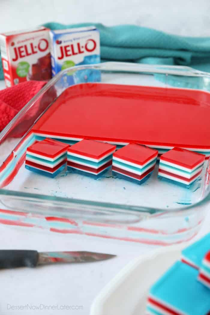 Red, white and blue layered jello cubes in dish.