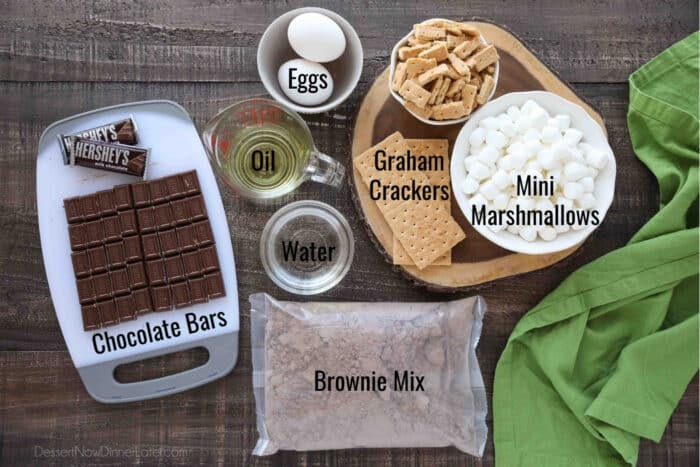 Ingredients for S'mores Brownies: Brownie Mix, Eggs, Oil, Water, Chocolate Bars, Graham Crackers, and Mini Marshmallows.
