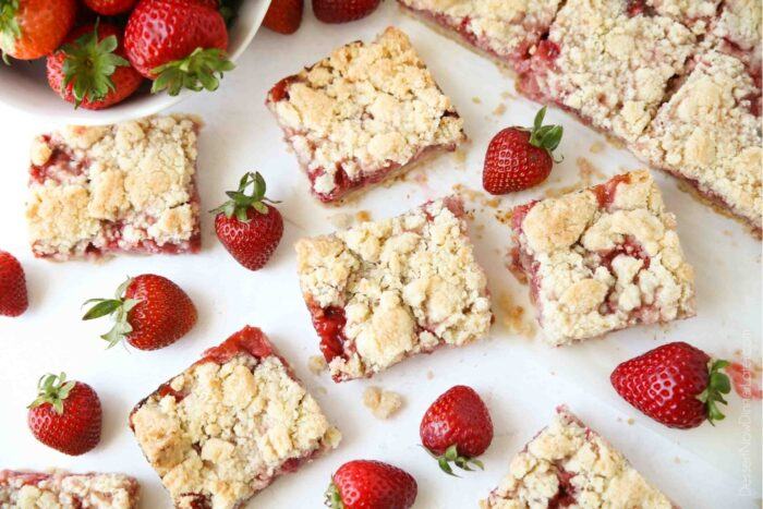 Strawberry Crumb Bars dessert squares with fresh strawberries.