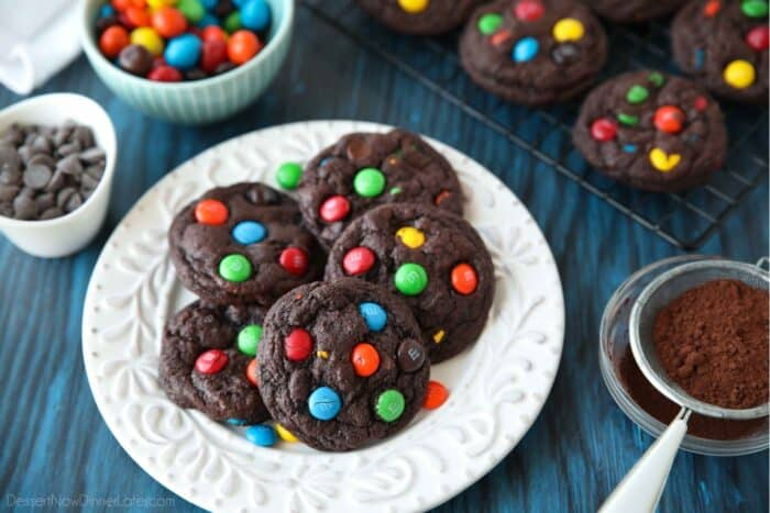 Plate full of chocolate M&M cookies with extra M&M's.
