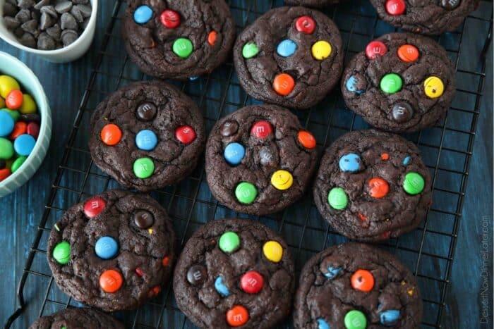 Cooling rack full of chocolate M&M cookies.