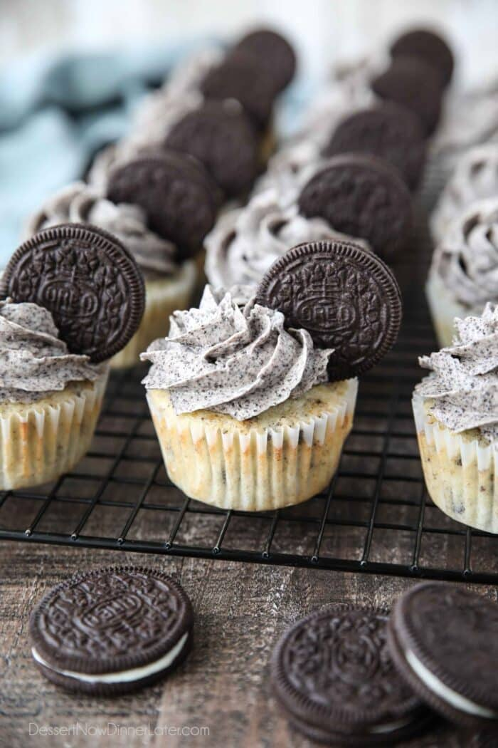 Closeup of vanilla cupcakes with Oreos inside and Oreo frosting on top with an Oreo cookie garnish.