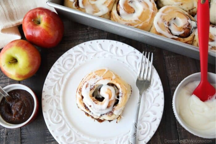 Top view of an apple butter cinnamon roll on a plate.