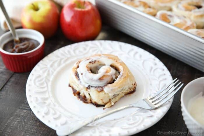 Side view of an apple butter cinnamon roll on a plate.