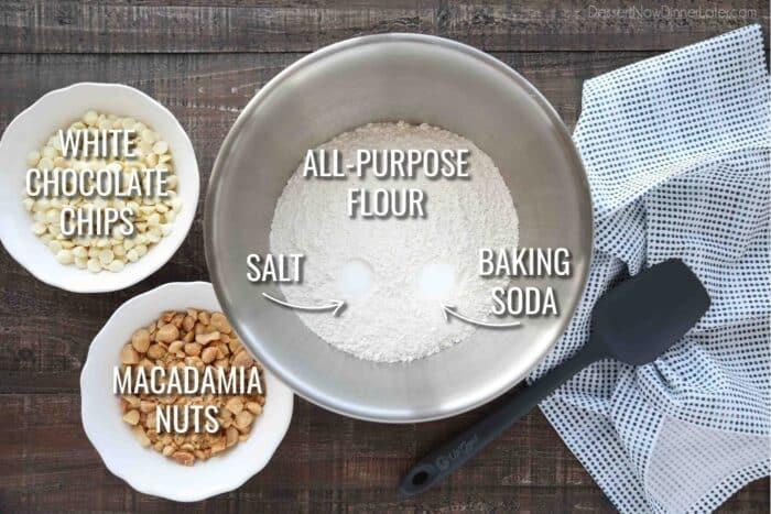 Dry Ingredients for White Chocolate Macadamia Nut Cookies: all-purpose flour, salt, baking soda, white chocolate chips, and macadamia nuts.