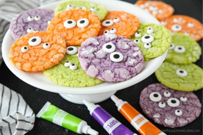 Side view of plate with colorful cookies topped with candy eyeballs.