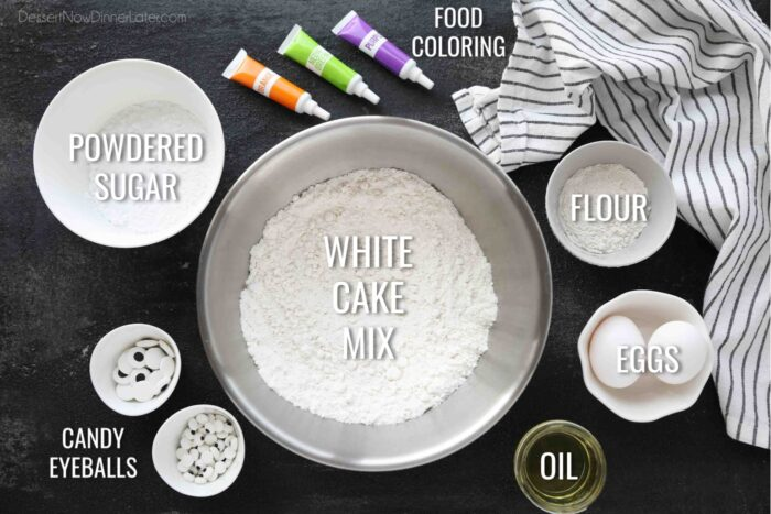 Ingredients for Halloween Monster Cookies: white cake mix, flour, eggs, oil, food coloring, powdered sugar, and candy eyeballs.