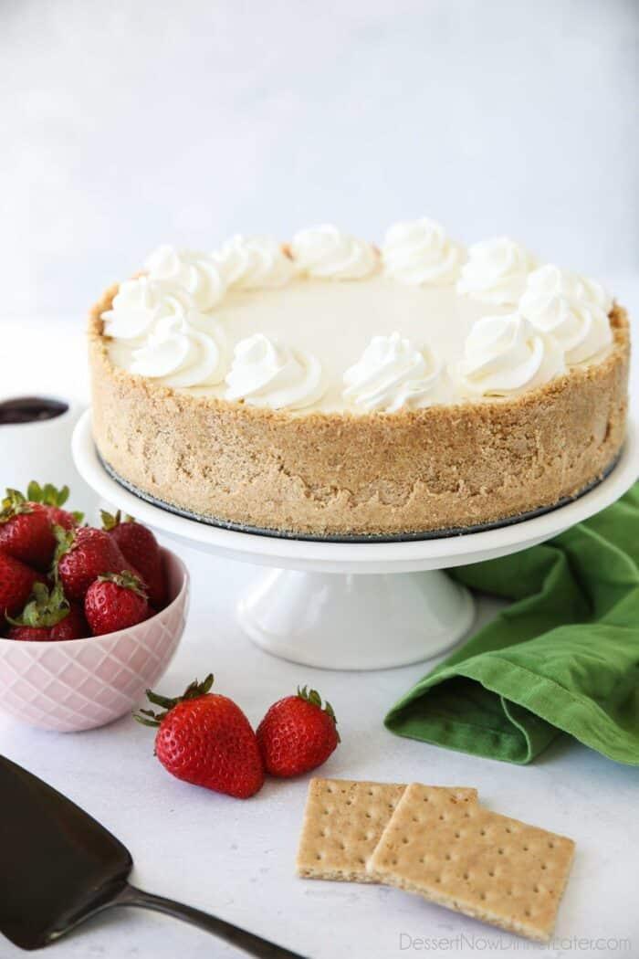 Whole no bake cheesecake on platter.